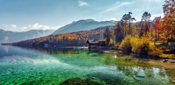 Wonderful Vivid nature scenery. Fantastic views of the turquoise alpine lake, Trees and majestic mountains, under sunlight. Amazing nature mountain landscape. beautiful background for design and post