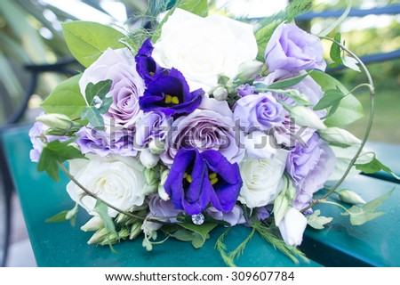 Wonderful wedding bouquet with purple, blue and white flowers