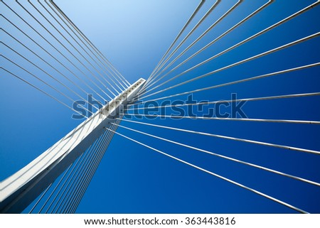 Wonderful white bridge structure over clear blue sky #363443816