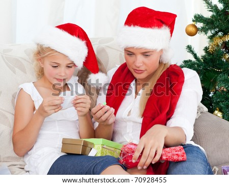 Wonderful woman on christmas day with her daughter at home