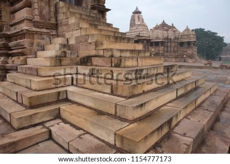 Wonderfully designed laid and contoured steps to the historical Kandariya Mahadev temple made of sandstones with another one called Jagdamba in the background Khajuraho Madhya Pradesh India Asia   #1154777173