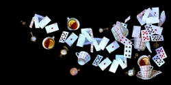 Wonderland background. Mad tea party.Playing cards, pocket watch, key, cup and teapot falling down on black background. Horizontal banner.