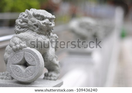 WONG TAI SIN TEMPLE LION  JULY 5: Chinese lion deity with old coin on July 5 2009 in Wong Tai Sin Temple, Hong Kong.Everyday Hong Kong people go to this temple to wish for good health and prosperity.
