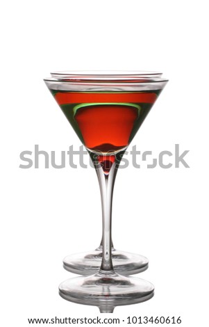 Woo woo cocktail with an Appletini behind, isolated on a white background. #1013460616