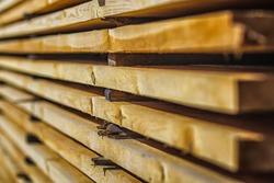 Wood air drying (seasoning lumber or wood seasoning). Timber. Lumber. Close-up. Wooden planks. Beams. Air-drying timber stack