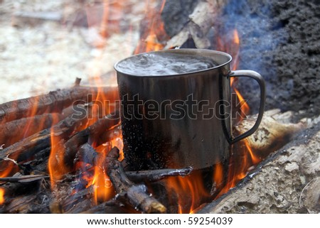 Wood and boiling water in big campfire
