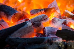 wood and coal burning in a BBQ