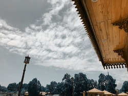 Wood art in kashmir in golden color. An art work on wood pillars roof on water river and wooden art.
