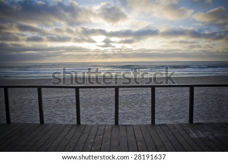 Wood balcony with view for the ocean by the sunset