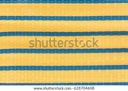 Wood Bamboo Mat Texture Background with yellow and blue line #628704608