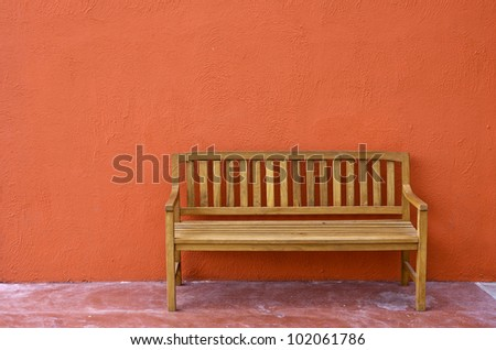 wood Bench Against blank Wall.