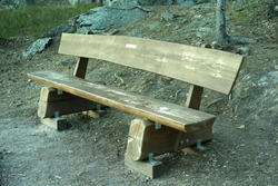 Wood bench in the forest for people to have a rest during walking.