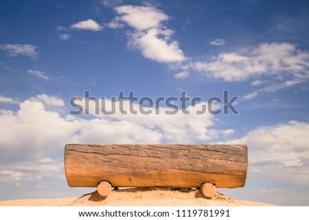 wood bench with cloudy sky view