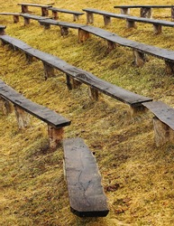 wood benches in rows
