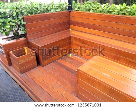 Wood benches on a public seating area. #1235871031