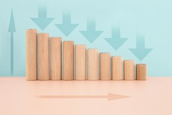 Wood block chart histogram or Infographics bar chart with arrow down in blue background, financial crisis crisis concept