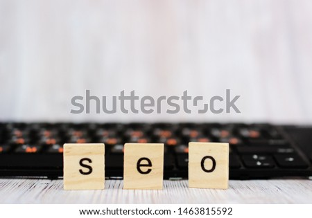 Wood block cube shape put the front computer keyboard with word SEO and empty copy space for your text. Search engine optimization concept