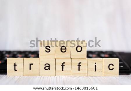 Wood block cube shape put the front computer keyboard with word SEO TRAFFIC and empty copy space for your text. Search engine optimization concept