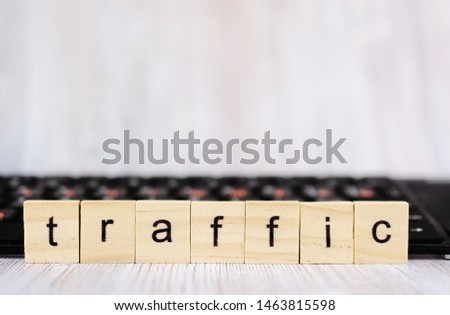 Wood block cube shape put the front computer keyboard with word TRAFFIC and empty copy space for your text. Search engine optimization concept