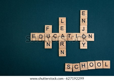 Wood block education word over backboard school. Education word formed by educational wood block. Education word concept for background.