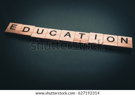 Wood block education word over backboard school. Education word formed by educational wood block. Education word concept for background.