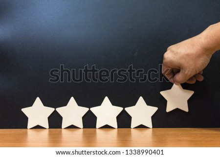 Wood block five star shape on wooden table black background. Block 5 stars rated best service excellence concept. Excellence customer vote quality satisfaction winners award. #1338990401