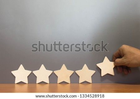 Wood block five star shape on wooden table gray background. Block 5 stars rated best service excellence concept. Excellence customer vote quality satisfaction winners award. #1334528918