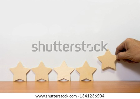 Wood block five star shape on wooden table white background. Block 5 stars rated best service excellence concept. Excellence customer vote quality satisfaction winners award. #1341236504