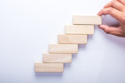 Wood block stacking as step stair, Business concept for growth success process.