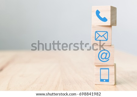 Wood block symbol telephone, mail, address and mobile phone, Website page contact us concept