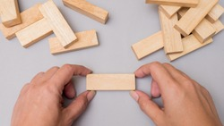 wood block  tower game with hand.Top view copy space