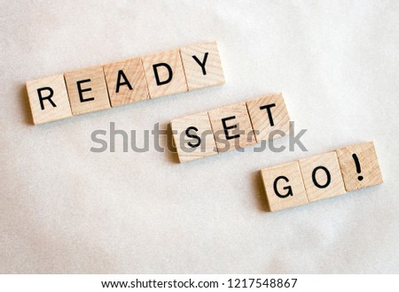 Wood blocks spell Ready Set Go! on a white background. Education and business concepts Foto d'archivio ©