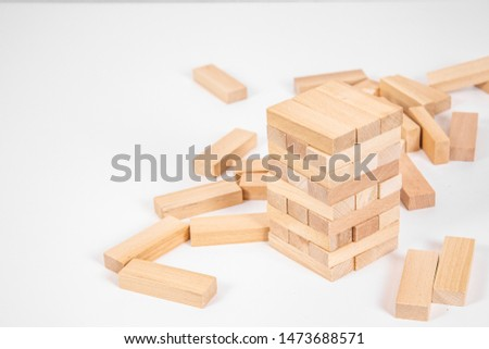 wood blocks tower game. planning, strategy and risk for business and finance. isolated background #1473688571