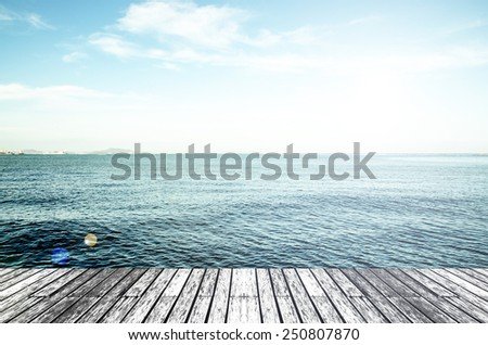Wood, blue sea and sky background
