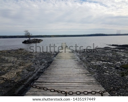 wood boardwalk or pier and river or water and chain