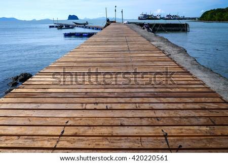 Wood bridge on the sea #420220561