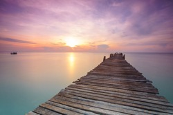 Wood bridge on the sea  between sunrise