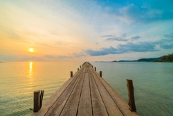 Wood bridge or pier on the beach and sea in paradise island at sunset time - Holiday Vacation and Travel concept