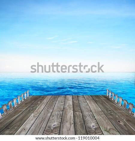 Wood bridge to blue sea