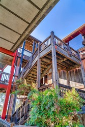 Wood building with stairway and balcony against blue sky in San Diego California