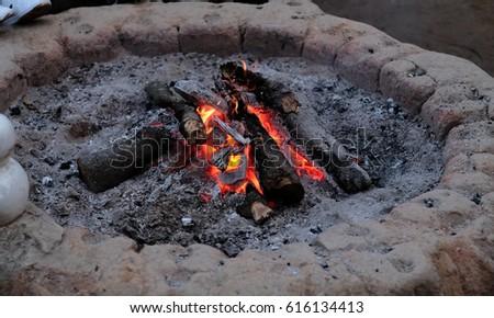 Wood burning in the fireplace closeup.(Selective focus) #616134413