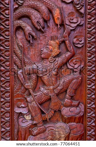 wood carving decorated at windows of the temple tells story about Lord Buddha, hand made by Thai artisan, Khonkaen,Thailand