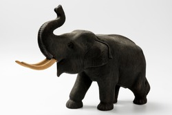 Wood carving elephant as a souvenir on white background with clipping path