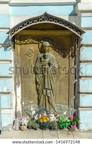 Wood carving entrance door of orthodox Church picturing Mother Mary and Jesus baby, Moscow