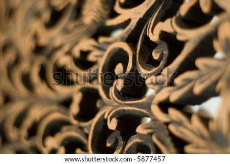 Wood carving of rose motif