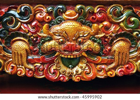 Wood carving of tibetan dragon