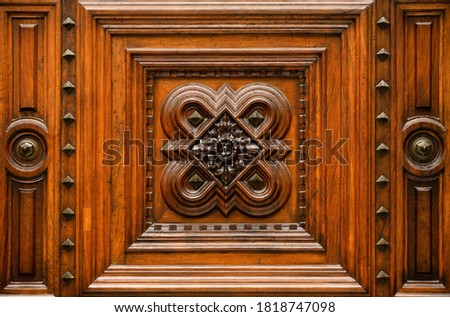 Photo of  Wood carving with inlay. Fragment of old wooden pattern.