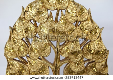 Wood carvings, gold color, white background.