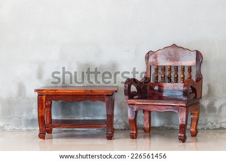 wood chair and table furniture and grunge concrete wall backgroud