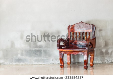 wood chair furniture and grunge concrete wall background
